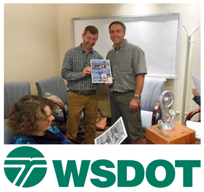 Washington State DOT logo underneath photograph of employees and the Gray Notebook Award trophy.